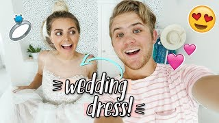 TRYING ON MY WEDDING DRESS 3 YEARS LATER! & Husband's Reaction!!