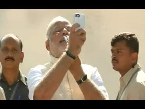 Narendra Modi cast his vote & Takes a selfie - Elections 2014