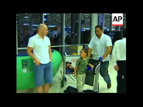 Evacuees arrive from riot-torn Tonga