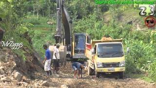 Excavator Volvo EC210B Loading Dump Truck Mitsubishi Fuso Canter