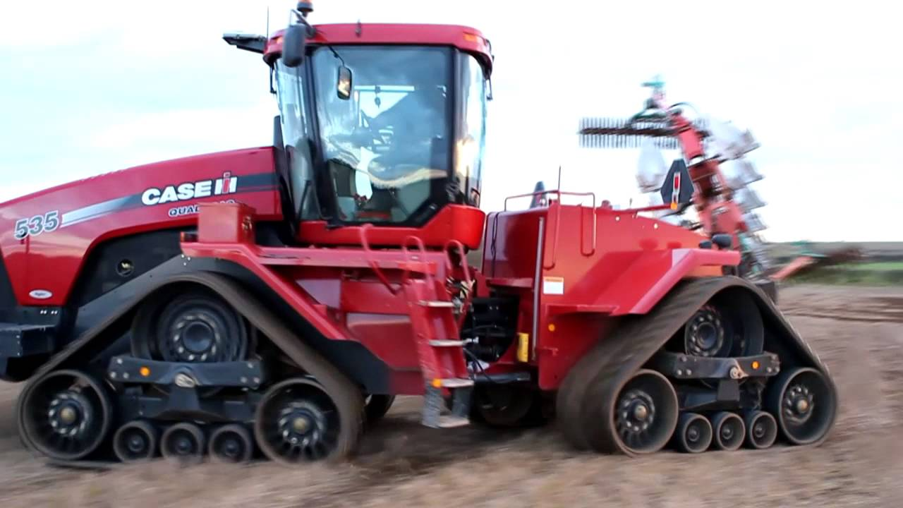 Case Quadtrac 535 with Kverneland 10 furrow semi mounted plough ...