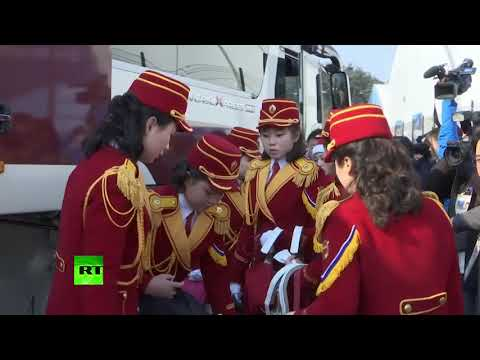 RAW: N. Korean cheerleading squads arrive at Olympic village