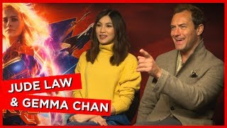 'You're damn right I do!': Jude Law and Gemma Chan talk wearing their own Captain Marvel merch!