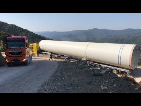 Huge Part Of A Wind Turbine Transporting By 2 Man Trucks - P