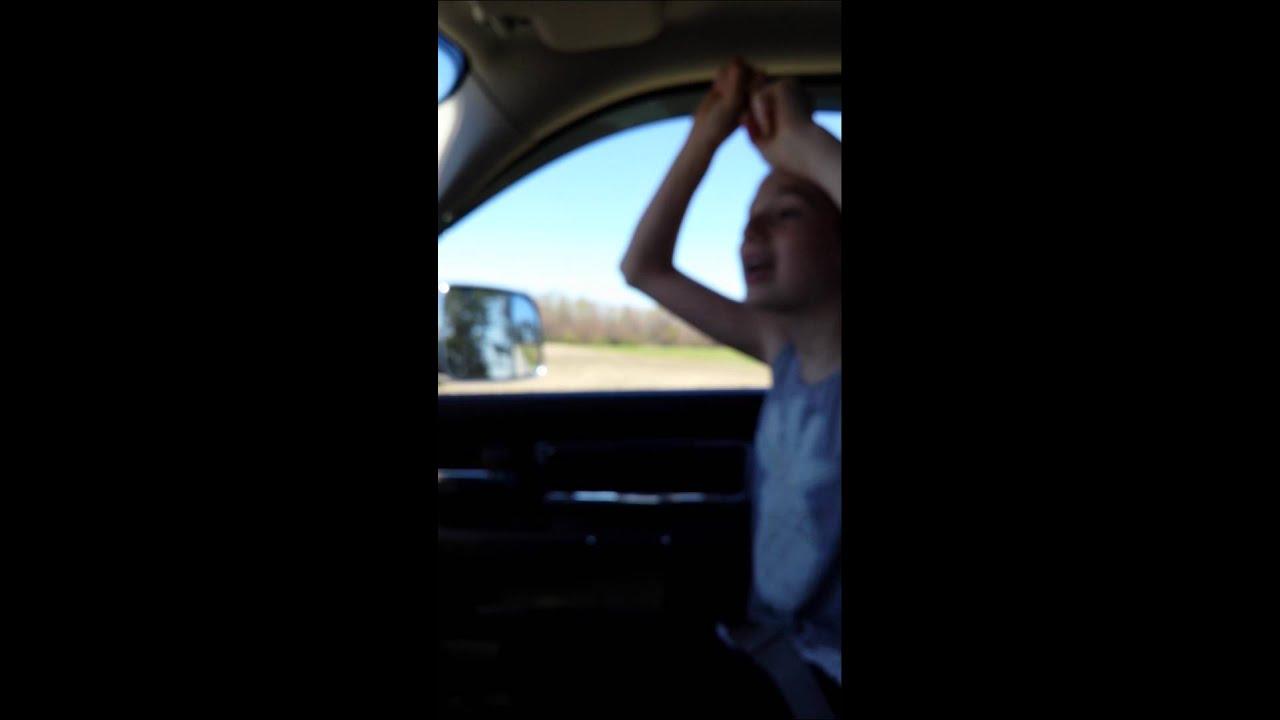 Dad and daughter singing in car