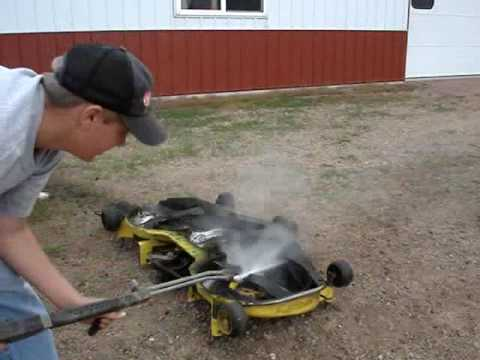 Cleaning Mower Deck By Pressure Washing