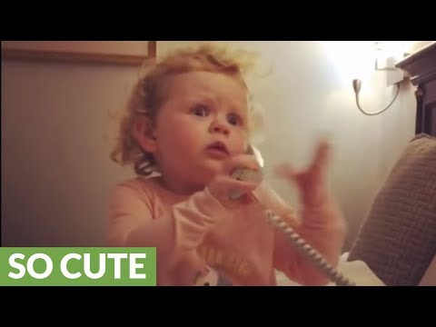 Sweet little girl adorably rambles on the telephone