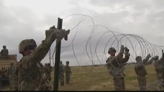 US troops add barbed wire to US-Mexico border