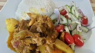 Chicken Curry Served With Rice And Salad