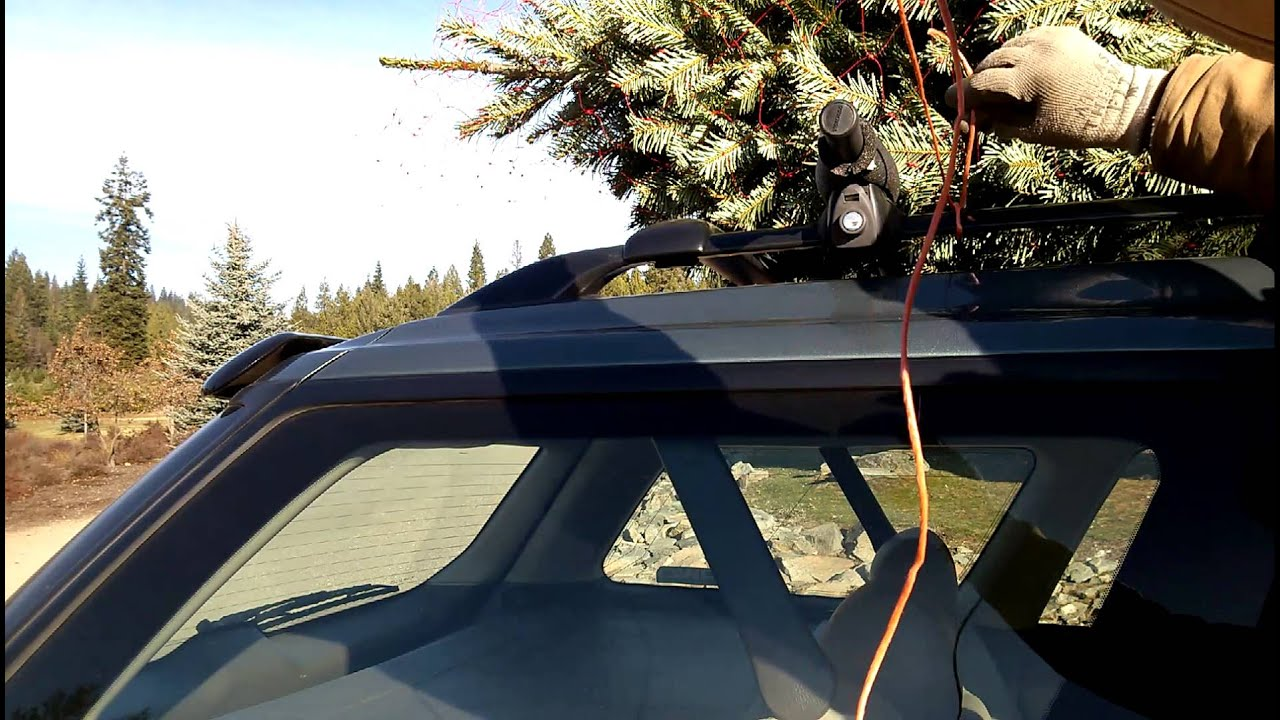 Tie Christmas tree to car (with a roof rack) - YouTube