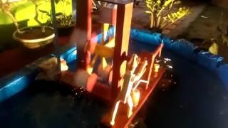 Pembuatan kincir air untuk kolam rumah