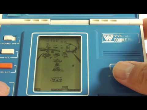 17864 Bandai LCD Game Solar Power Airport Panic