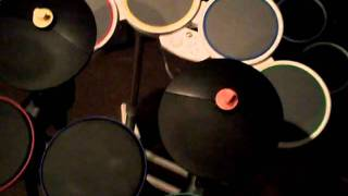 How Guitar Hero drums function in the Rock Band series of games on Nintendo Wii