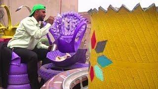 محافظاً على البيئة.. فنان يمني يصنع أثاثاً من الإطارات المستعملة