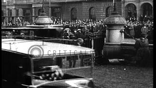 Eamon de Valera and other men arrive in cars as crowd waits outside the building ...HD Stock Footage