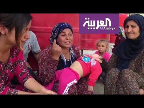 امرأة كردية تحمل طفلتها القتيلة وتتساءل: ماذا يريد أردوغان منا؟  - 19:54-2019 / 10 / 12