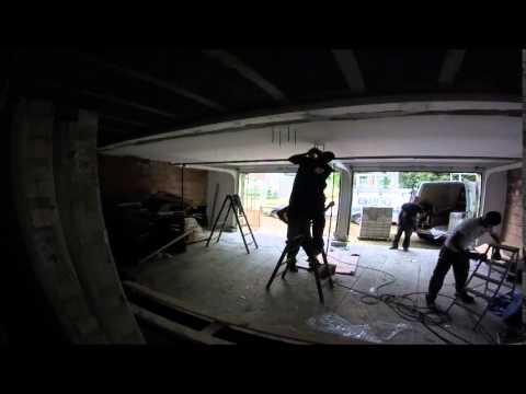 how to fix a garage door that goes down crooked