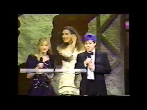 Sarah Polley, Mag Ruffman, and Zachary Bennett present an award