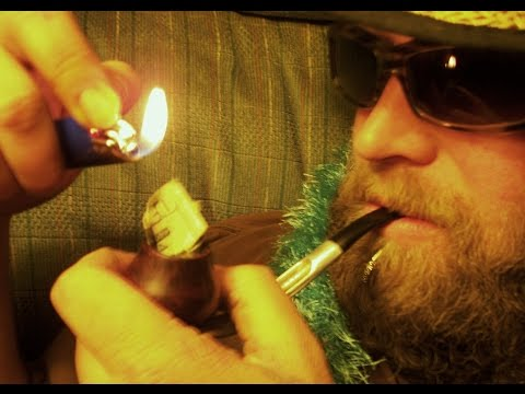 Smoking Money $20 Dolar Bill in a Pipe