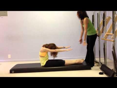 Elle Jardim Teaching The Five Fundamental Mat Exercises