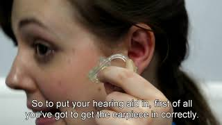 How to put in and remove an earmould hearing aid