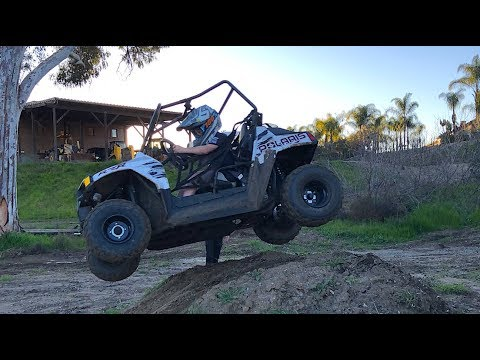 8 YEAR OLD DRIVING A RZR!!!