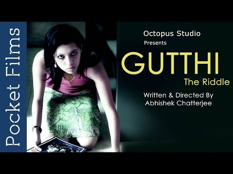 Gutthi (The Riddle) - Award Winning Suspense Short Film | Pocket Films: Gutthi ( The Riddle ) is a story about a night-long conversation between a writer, Anand Rajan, and a garbage collector, Khalil. A night that leads to shocking revelations and the unlocking of several mysteries in their lives. Anand Rajan, who is a noted writer, is suffering from writer's block, when he catches Khalil, the garbage collector going through his dustbin.He then invites Khalil over for a session of weed and what unfolds is something nobody will anticipate.  What can a garbage collector and a noted writer have in common ? And yet when they start talking, astonishing secrets start coming out! Watch '#Gutthi' to solve this mystery...#pocketfilms #shortfilms #suspense   Subscribe to our channels for a new short film every day - http://goo.gl/lPLIY  For More Suspense Film Online   U http://bit.ly/1mTZLnr  New Release of the Week   U http://bit.ly/1koAbDv  Visit www.pocketfilms.in to know more about us and our activities including film contests, updates, etc.  Cast & Crew:     Director: Abhishek Chatterjee     Music / Sound: Samik Roy Chowdhury     Editor: Jim George     Cinematographer: Vamshi Kore     Actors: Rathna Shekar Reddy, Choeeta Chakrabarti, Naren Yadav  Are you a film maker? Want to showcase your film / documentary and also generate income? Contact us at -  info@pocketfilms.in