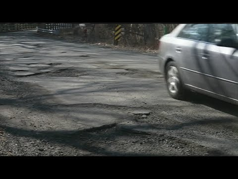 Drivers in Westfield dodging potholes on the road