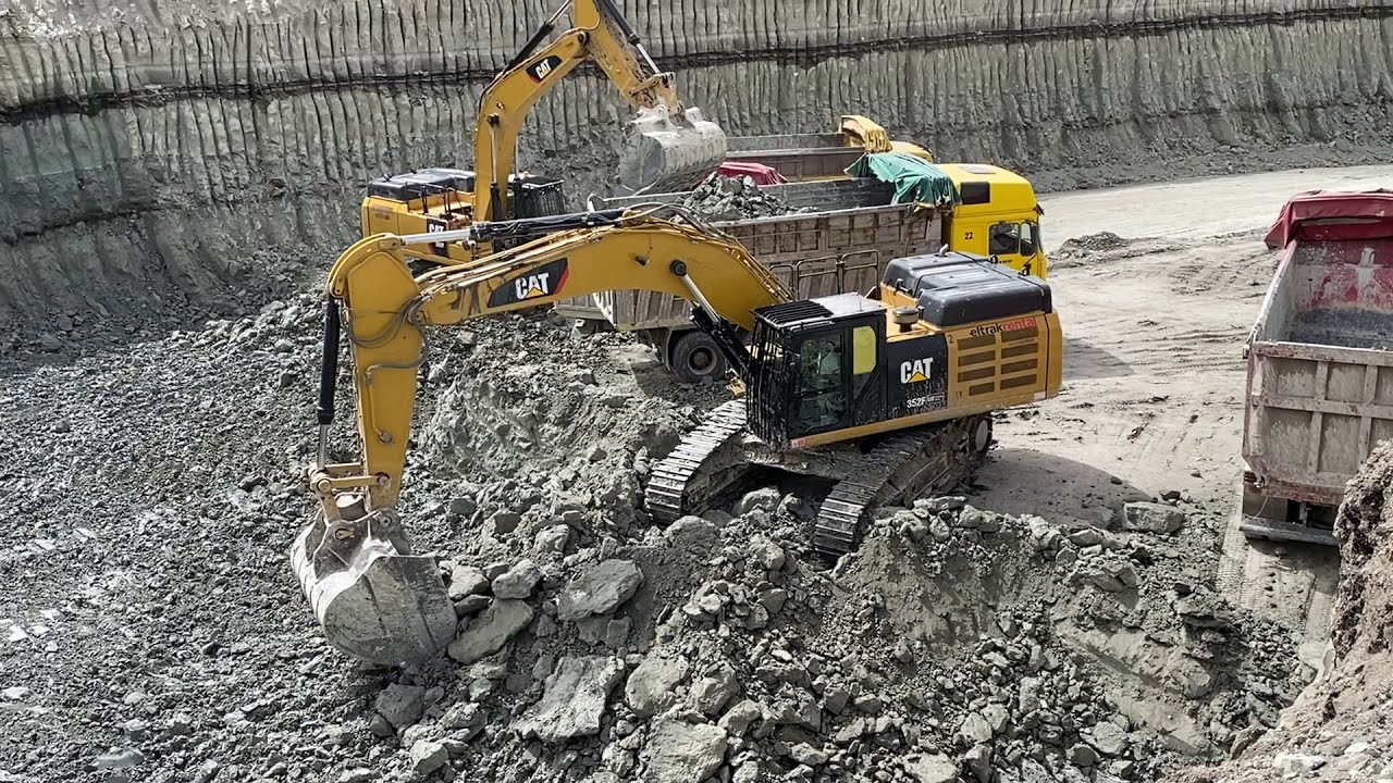 Caterpillar 352F Excavators Loading Trucks