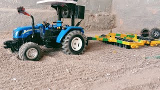 New holland 6010 with 12×12 taviyan | harrow |toy tractor working at fields