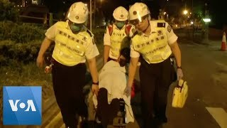 Hong Kong Protesters Evacuated From University by Medics