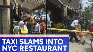 Video shows taxi crashing into Manhattan restaurant