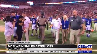 Jim McElwain smiles as he walks off the field after UGA loss
