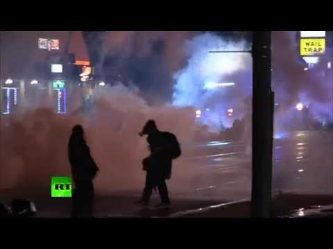 RAW: Ferguson police fire tear gas at defiant protesters
