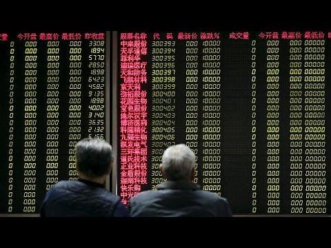 Шанхайская биржа закрылась в плюсе после приостановки механизма автоматического прекращения торгов