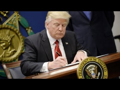 Trump signs revised executive order exempting Iraq from travel ban