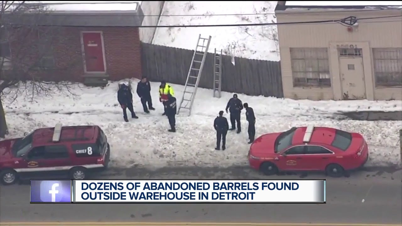 Fire marshal investigating unidentified barrels found behind building in northeast Detroit
