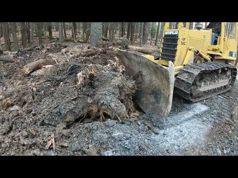 Clearing land with a dozer