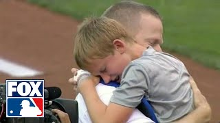 Military dad surprises son after first pitch in Kansas City