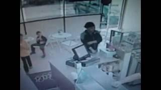 A Woman Robs an ice cream shop very daring