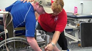 Paraplegic transfer from a wheelchair to a floor mat by twisting