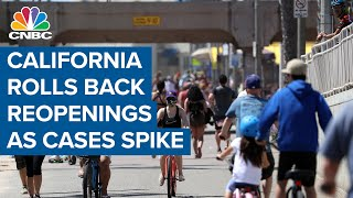 California pulls emergency break on reopening as Covid-19 cases spike