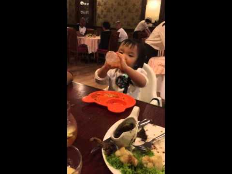 Funny Little Baby eating spaghetti