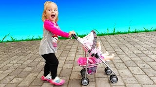 Little Girl Elis Outdoor Activity with Baby Doll in Stroller - Shovel Toys Sand Mold Play Family Fun