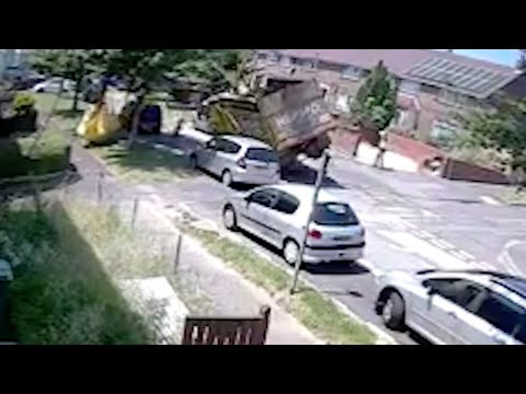 Disposal Truck Falls Over And Crushes Car