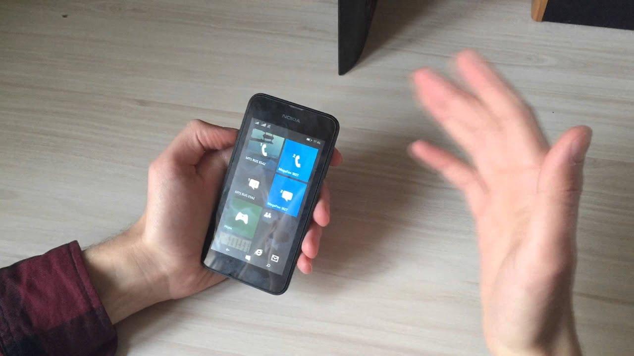 обзор спустя время быушного б/у мобильного телефона смартфона .