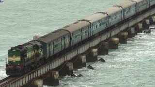 Train crossing Pamban bridge on a windy day.