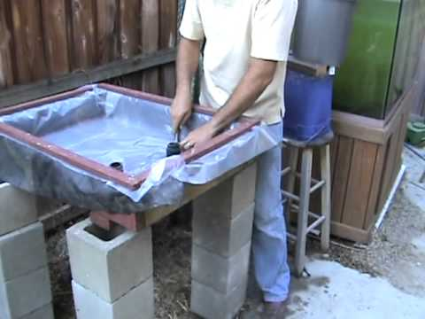 adding liner and drain to homemade hydroponic grow bed