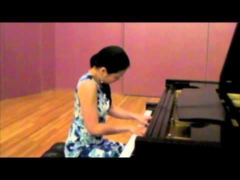 Joyce Yang demonstrates her piano skills