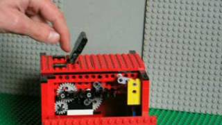 clockwork LEGO Useless Machine -- turns itself off